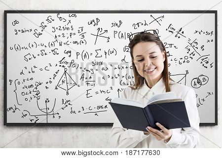 Formulas On Whiteboard And Woman With Book