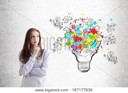 Pensive Young Woman With Creative Ideas