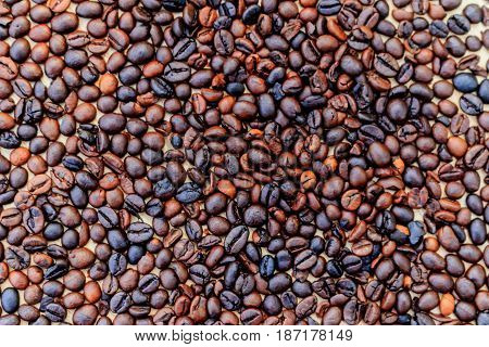 Brown roasted coffee beans (selective focus) .