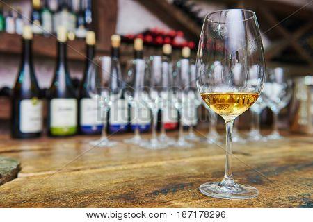 white glass of wine for tasting