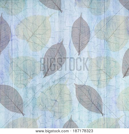 Antique Blue Cracked Linen Background with Leaves