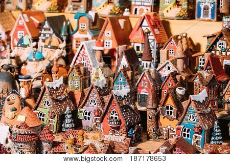 Traditional Souvenirs Small House Toys At European Market. Funny Souvenir From Tallinn, Estonia, Europe.