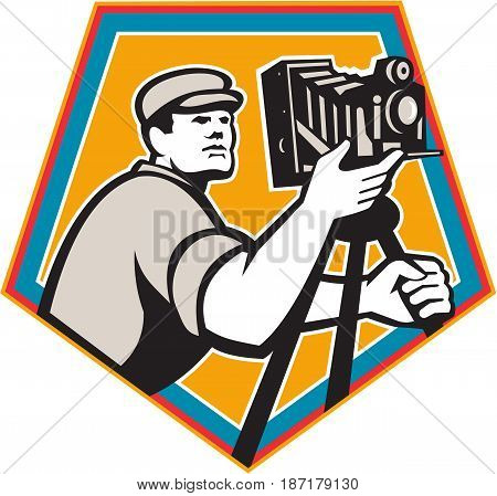 Illustration of a cameraman movie director with vintage movie film camera viewed from low angle set inside shield crest on isolated background done in retro style.
