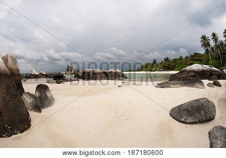 Natural Rock Formation In Sea And On White Sand Beach With Palm Trees In Belitung Island In The Afte