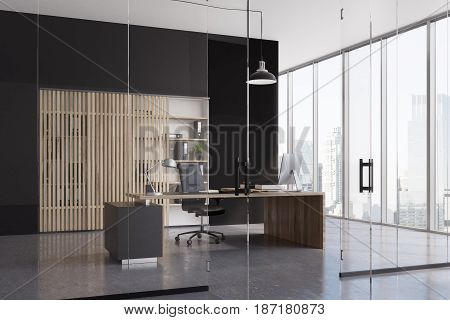 CEO office interior with a black and a glass wall a panoramic window a black wooden table and a bookshelves behind it. 3d rendering