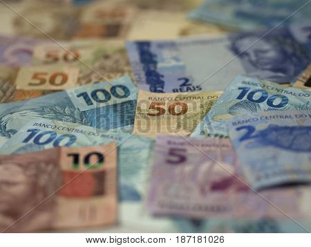 Brazilian currency money coins unfocused close-up business concepts