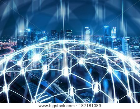 Glowing network in the shape of a globe is situated against a blurred night city background. Concept of globalization