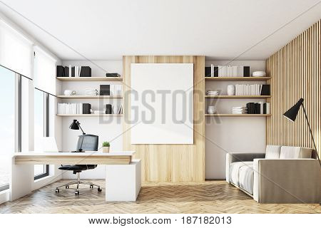 Front view of an office with light wooden walls a desk with a laptop a gray sofa bookshelves and a poster. 3d rendering mock up