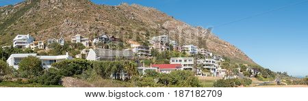 GORDONS BAY SOUTH AFRICA - MARCH 29 2017: Luxury homes against the Hottentots Holland Mountains in Gordons Bay near Cape Town.