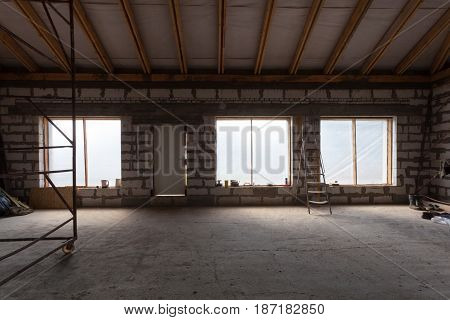Interior of apartment with ladder during under renovation remodeling and construction (preparing to plaster)