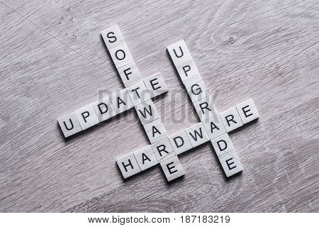 Software hardware update and upgrade words made of wooden cubes