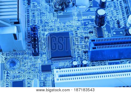 Integrated Semiconductor Microchip Microprocessor On Blue Circuit Board Representative Of The High T