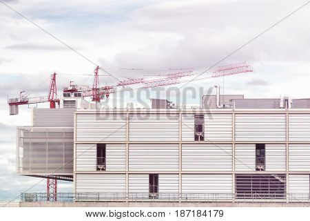 Crane and building construction site. Crane and white temporary construction frame.