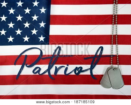 word patriot and military dog tags on American flag