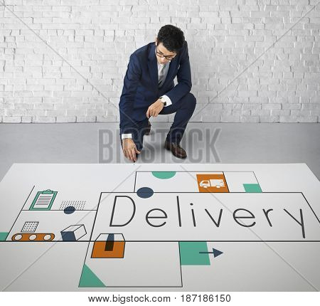 Man working on network graphic overlay banner on floor