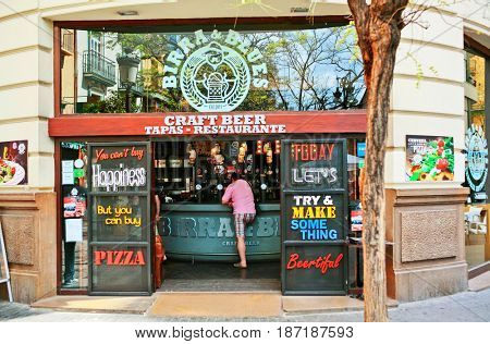 VALENCIA, SPAIN - APRIL 23, 2016: The entrance to the Birra & blues bar, in which passers can refresh the craft ale and beer.Bar is located at Maria Cristina street, 12 (San Fernando) 46002 Valencia