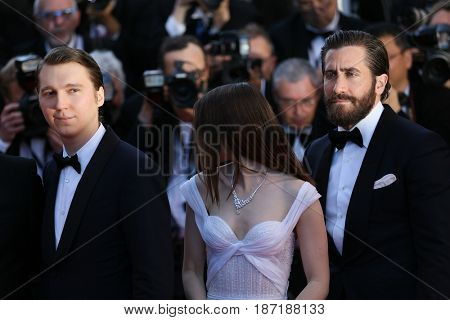 Paul Dano, Lily Collins and Jake Gyllenhaal  attends the 'Okja' screening during the 70th annual Cannes Film Festival at Palais des Festivals on May 19, 2017 in Cannes, France.