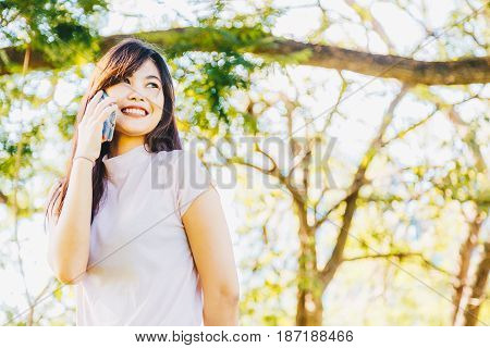 Beautiful Asian Woman Using On The Smart Phone With Feeling Relax And Smilng Face