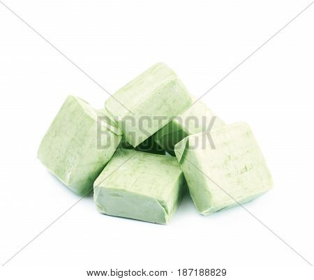 Pile of fruit flavoured chewing candies isolated over the white background