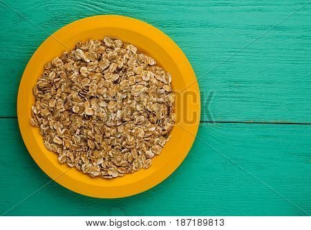 Oatmeal On A Wooden Table. Oatmeal Top View. Healthy Food