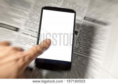 Fake newspaper and smartphone with blank screen. business communication concept.
