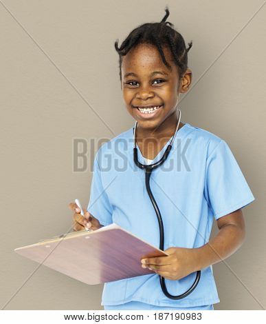 Little girl with doctor dream job smiling