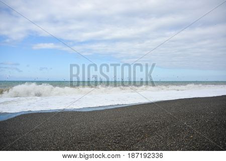 Waves on the pebble beach of the sea during a storm