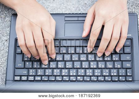 finger at laptop keyboard. working lifestyle closeup business woman typing on computer.