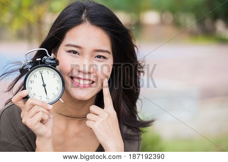 Baby Face Time, Timeless Cute Asian Women Girl With Young Skin Look With Clock Time.