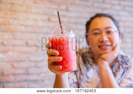 Fatty women tubby drinking fruit smoothie fruit healthy drink good for diet and cool ice for hot day in summer season.