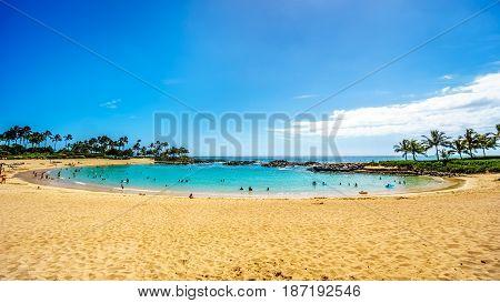 Blue sky and and white sand at Ko Olina Lagoon 3, named Nai'a Lagoon, at the resort community of Ko Olina on the West Coast of the Hawaiian island of Oahu