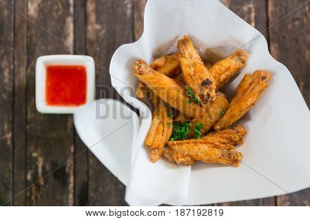 Crispy Chicken Wing. Thai Style Fried Appetizer Or Snack Food With Chilli Pepper Flavoring And Hot S