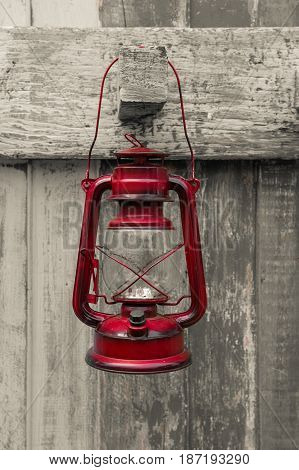 Western Style Oil Lantern, Red Old Lamp Vintage Style Hang On Wood Background.