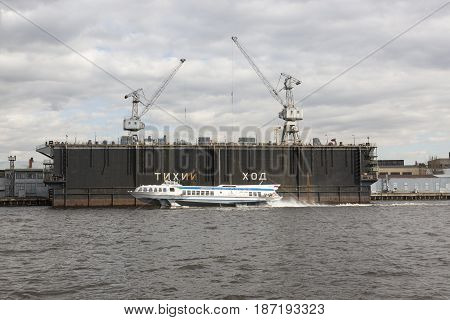Saint Petersburg, Russia,may 03, 2017:The ship is moving in front of the floating dock. The Neva River, St. Petersburg.