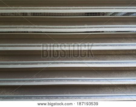 grey metal vent closeup with horizontal lines