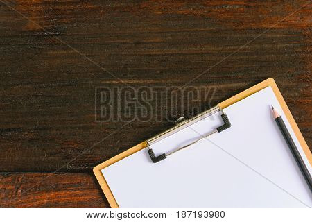 Clipboard And Pen On Old Wood Table