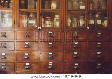Old Herbal Medical Shop Retro Chinese Style Seasoning Collection Wood Cabinet In Herb Store.