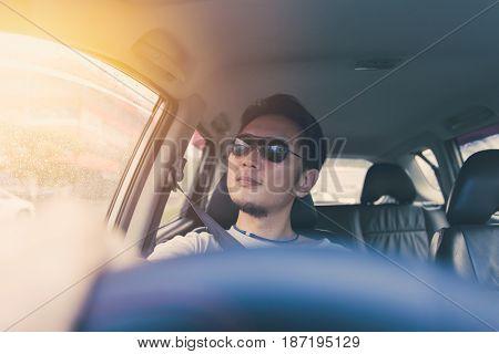 Asian Thai Chinese Man Male Ware Black Sun Glass Drive A Car In Hot Summer Day Travel.