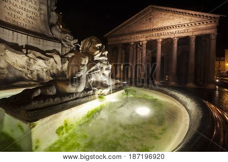 Pantheon, historic building landmark in Rome, Italy and fountain. Night. Commissioned by Marcus Agrippa during the reign of Augustus (27 BC - 14 AD) and rebuilt by the emperor Hadrian about 126 AD.