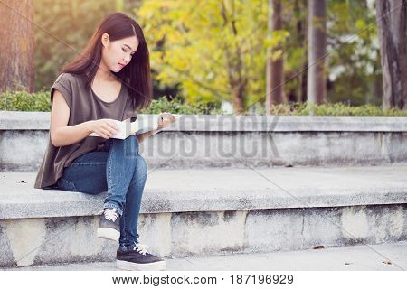 Asian Teen Women Reading Book Happiness And Smile Enjoy Education In University.
