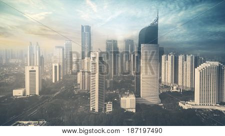 JAKARTA Indonesia. May 19 2017: Aerial view of Jakarta skyline with skyscrapers at sunset time