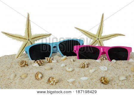 Sun glasses and starfishes on the sand beach isolated on white background