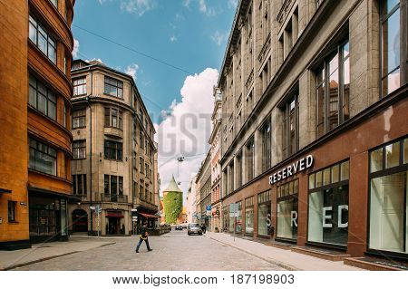 Riga, Latvia - July 2, 2016: Man Walking Near Shop Reserved On Valnu Street. Reserved Is A Polish Clothing Store Chain, Part Of LPP, Which Has More Than 1, 600 Stores Located In 18 Countries