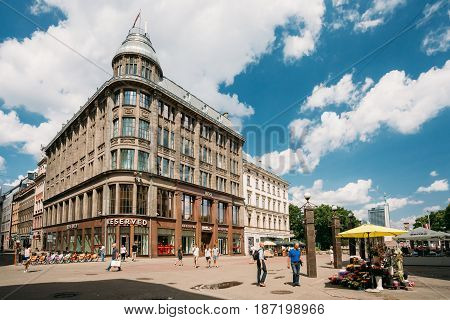 Riga, Latvia - July 2, 2016: People Walking Near Shop Reserved On Valnu Street. Reserved Is A Polish Clothing Store Chain, Part Of LPP, Which Has More Than 1, 600 Stores Located In 18 Countries