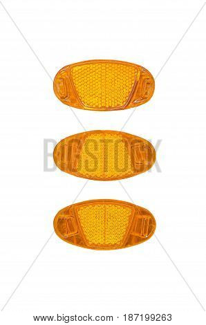 Yellow bicycle light reflectors isolated on white background