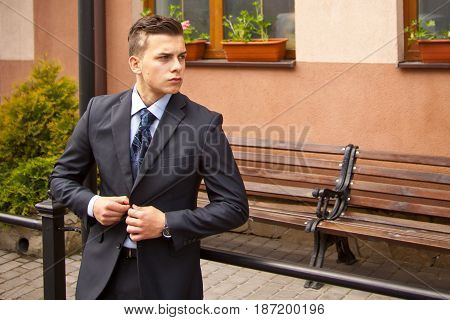 Handsome Young Businessman Walking On City Street In The Morning Going To Work In Office. Urban Life