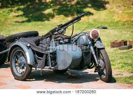 The Old Rarity Blue Tricar, Three-Wheeled Motorbike With The Machine Gun On Sidecar Of Wehrmacht, Armed Forces Of Nazi Germany Of World War 2 Time In Summer Sunny Park.
