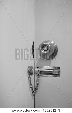 Door security chain locks style black and white and empty space for text