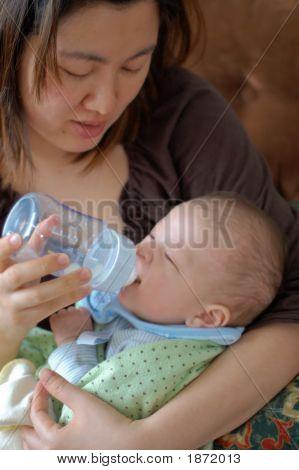 Mother Feeding Baby Boy