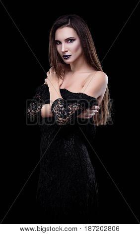 Studio fashion shot: dramatic portrait of a sexy beautiful young woman in black dress